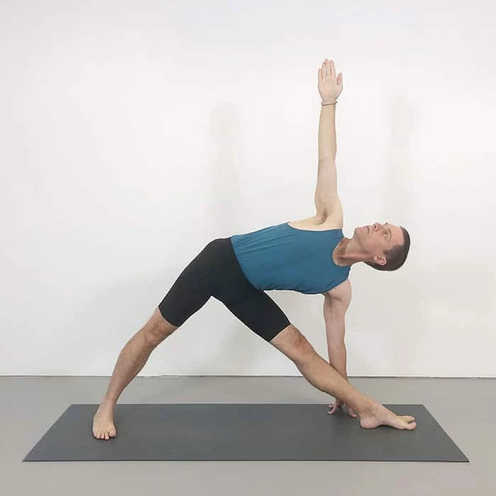 Triangle pose of yoga for runners